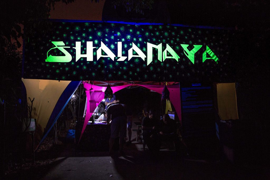 The entrance to wonderland Shalanaya Psytrance Festival in China. Letters are written with lead paint. In the backround are glowing stars. It`s magic.